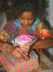 cake with pink and purple icing